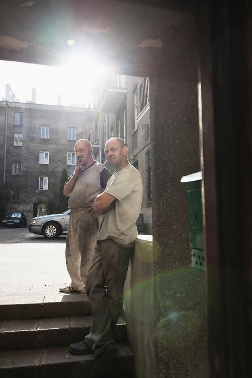 Robert Stanisławski and Eugeniusz Kazimierczak take a break outside their workshop in the Praga district of Warsaw, Poland. (September 2015)