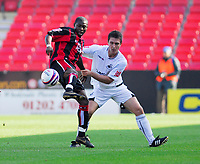 Photo: Leigh Quinnell.<br /> Bournemouth v Swansea City. Coca Cola League 1. 14/10/2007. Bournemouths Jo Kuffour battles for the ball with Swanseas Marcos Painter.