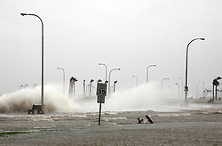 28 August 2012. New Orleans, Louisiana,  USA. .Flood waters crash over the sea wall as Lake Pontchartrain pours over the lake side of the levee. Hurricane Isaac spins in the Gulf just waiting to come ashore. The 7th year anniversary of Hurricane Katrina is tomorrow and with a storm lurking in the Gulf many in the city are on edge..Photo; Charlie Varley.