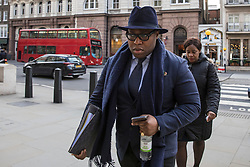 © Licensed to London News Pictures. 23/02/2018. London, UK. Lanre Haastrup (L) and his wife, Takesha Thomas (R), parents of 11-month-old Isaiah Haastrup, arrive at the High Court in London. Judges are set to rule on whether doctors at King's College Hospital can withdraw life support for Isaiah who suffered severe brain damage. Photo credit: Rob Pinney/LNP