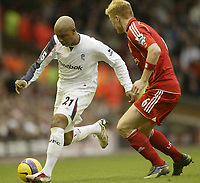 Photo: Aidan Ellis.<br /> Liverpool v Bolton Wanderers. The Barclays Premiership. 01/01/2007.<br /> Bolton's El Hadji Diouf looks to take on Liverpool's John Arne Riise