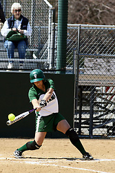 05 April 2008: Lisa Narotsky makes contact with the pitch. The Carthage College Lady Reds lost the first game of this double header to the Titans of Illinois Wesleyan 4-1 at Illinois Wesleyan in Bloomington, IL