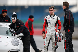 Dino Zamparelli debriefs with his driver coach after he drives the Parr Motorsport run Bristol Sport Racing Porsche 911 GT3 Cup - Photo mandatory by-line: Rogan Thomson/JMP - 07966 386802 - 30/01/2015 - SPORT - MOTORSPORT - Towcester, England - Silverstone Circuit - Dino Zamparelli Test Day - Porsche Carrera Cup GB.