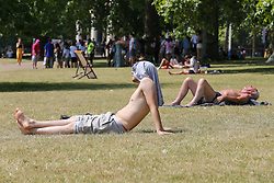 © Licensed to London News Pictures. 25/07/2019. London, UK. People sunbathes on a hot and sunny day in St James's Park. According to the Met Office, today will be the hottest day of the year and temperatures are expected to break records. Photo credit: Dinendra Haria/LNP