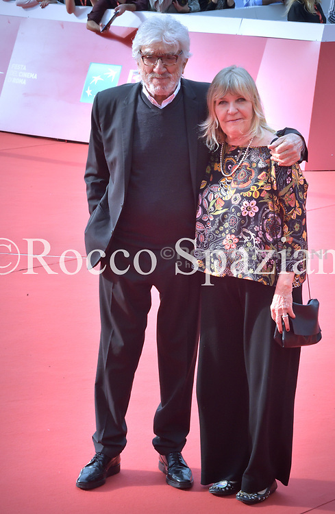 Gigi Proietti and Sagitta Alter walks a red carpet during the 13th Rome Film Fest at Auditorium Parco Della Musica on October 25, 2018 in Rome, Italy. on October 27, 2018 in Rome, Italy.
