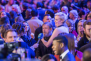 Gwendoline Christie enjoys the tv interviews with Mark Hamill - The European Premiere of STAR WARS: THE FORCE AWAKENS - Odeon, Empire and Vue Cinemas, Leicester Square, London.