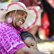 Golden Anderson, of Atlanta, holds her god daughter Amali Anderson, 5, while listening to the songs of The Geechee Gullah Ring Shouters during the Gullah Festival at the  Technical College of the Lowcountry on May 24, 2014.