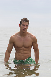 man with a great body coming out of a lake