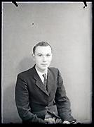 vintage formal studio portrait of young adult man, circa 1930s