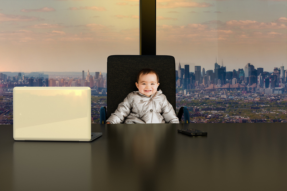 A one year old baby girl role playing as the CEO of a big company in New York City.