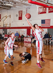 Laconia's Ryan Stone goes for a layup during Friday's game at Laconia High School.  (Alan MacRae/for the Laconia Daily Sun)