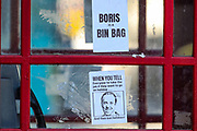 London, England, the United Kingdom, July 16, 2021: (EDITOR'S NOTE: Use of Strong profanity Language) A general picture shows a protest message sticker attached at the red telephone box near Downing Street targeting Britain's Prime Minister Boris Johnson in central London on Friday, July 16, 2021. England prepares to lift all covid restrictions from 19th July amid different approaches to mask-wearing from local governments to private companies. The UK recorded more than 50.000 covid cases this week, the highest daily number in months. (VX Photo/ Vudi Xhymshiti)