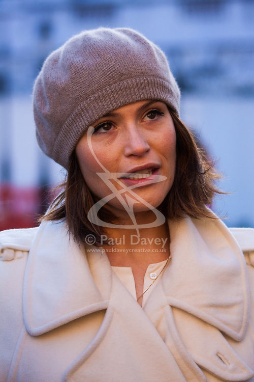 Westminster, London, December 16th 2014. Actress Gemma Arterton who stars in the West End Musical Made in Dagenham, speaks to the media outside parliament as she lends her voice to the campaign for pay transparency, which aims to force employers into revealing payscales for both genders.