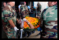 30th August, 2005. Triage at the Superdome in New Orleans. A pregnant woman goes into labour following her rescue from the flooded lower 9th ward.