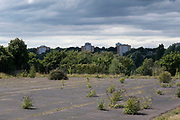 View looking down across overgrown and disused waste ground from Balsall Heath towards tower blocks of high rise flats in Edgbaston on 3rd August 2020 in Birmingham, United Kingdom. Birmingham is undergoing a massive transformation called the Big City Plan which involves the controversial regeneration of the city centre as well as a secondary zone reaching out further. The Big City Plan is the most ambitious, far-reaching development project being undertaken in the UK. The aim for Birmingham City Council is to create a world-class city centre by planning for the next 20 years of transformation.