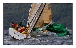 Yachting- The first days inshore racing  of the Bell Lawrie Scottish series 2002 at Tarbert Loch Fyne. Near perfect conditions saw over two hundred yachts compete. <br />Sloe Jinn SJ320 GBR9769R and Megawatt Hanse 371 IRL11111 in Class 3<br />Pics Marc Turner / PFM