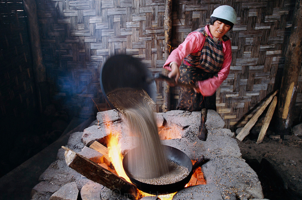 Jombey Lhakhang roasting barley in a monestary in the Bumthang Valley, Bhutan. (Supporting image from the project Hungry Planet: What the World Eats.)