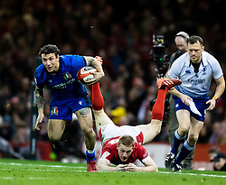 Matteo Minozzi of Italy evades the tackle of Johnny McNicholl of Wales<br /> <br /> Photographer Simon King/Replay Images<br /> <br /> Six Nations Round 1 - Wales v Italy - Saturday 1st February 2020 - Principality Stadium - Cardiff<br /> <br /> World Copyright © Replay Images . All rights reserved. info@replayimages.co.uk - http://replayimages.co.uk