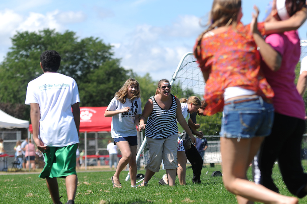 Resurrection High School students and friends compete in a three-legged race during a back to school picnic celebrating the 90th anniversary of the all-girls College Prep school on Chicago's Northwest side  on August 28, 2011 l Brian J. Morowczynski~ViaPhotos..For use in a single edition of Catholic New World Publications, Archdiocese of Chicago. Further use and/or distribution may be negotiated separately. ..Contact ViaPhotos at 708-602-0449 or email brian@viaphotos.com.   .