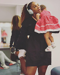 """Serena Williams releases a photo on Twitter with the following caption: """"""""As I head into next year it's not about what we can do it's what we MUST do as working moms and working dads. Anything is possible. I am getting ready for the first match of the year and my dear sweet baby @olympiaohanian was tired and sad and simply needed mama's love."""""""". Photo Credit: Twitter *** No USA Distribution *** For Editorial Use Only *** Not to be Published in Books or Photo Books ***  Please note: Fees charged by the agency are for the agency's services only, and do not, nor are they intended to, convey to the user any ownership of Copyright or License in the material. The agency does not claim any ownership including but not limited to Copyright or License in the attached material. By publishing this material you expressly agree to indemnify and to hold the agency and its directors, shareholders and employees harmless from any loss, claims, damages, demands, expenses (including legal fees), or any causes of action or allegation against the agency arising out of or connected in any way with publication of the material."""