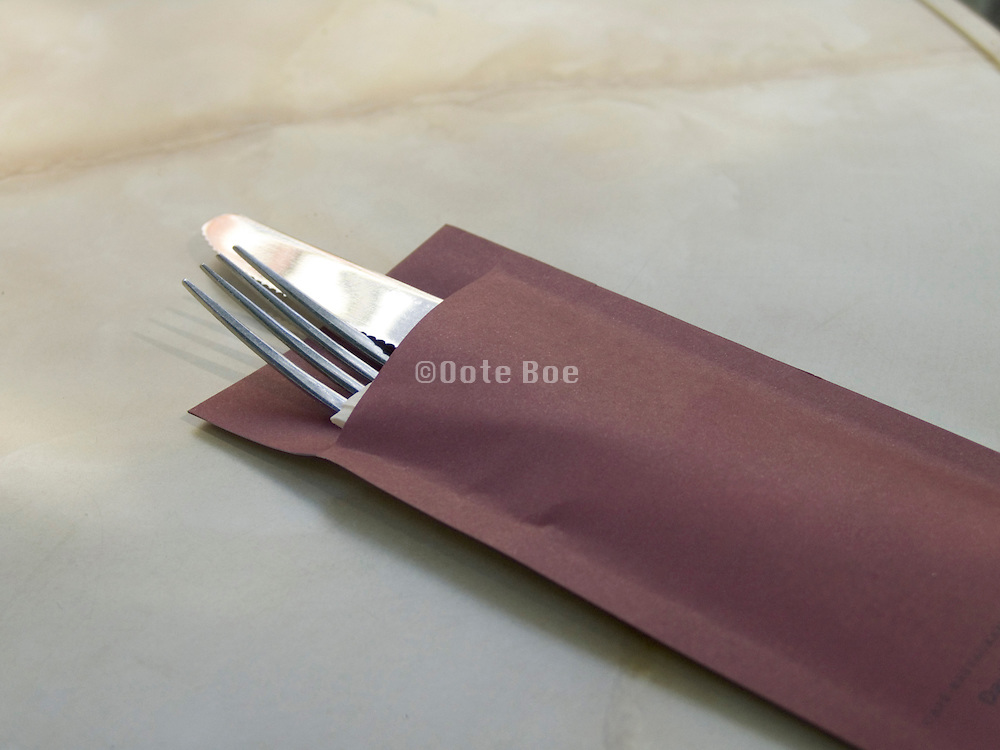 close up of fork and knife laying on a table