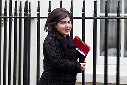 "© under license to London News Pictures. 5th August 2014 Foreign Office minister Baroness Warsi has resigned from the government, saying she can ""no longer support"" its policy on Gaza. FILE PICTURE DATED 07/01/2013. London, UK. Minister without Portfolio Baroness Warsi is seen on Downing Street in London today (07/01/13) before the first cabinet meeting of 2013. Photo credit: Matt Cetti-Roberts/LNP"