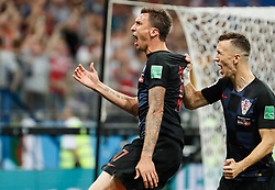 July 1, 2018 - Nizhny Novgorod, Russia - Mario Mandzukic (C) of Croatia national team celebrates his goal with Ivan Perisic during the 2018 FIFA World Cup Russia Round of 16 match between Croatia and Denmark on July 1, 2018 at Nizhny Novgorod Stadium in Nizhny Novgorod, Russia. (Credit Image: © Mike Kireev/NurPhoto via ZUMA Press)