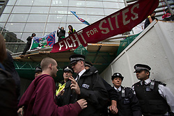 © licensed to London News Pictures. London, UK 19/10/2012. Protester arguing with police officer outside Department for Communities and Local Governments in London during a protest to mark the first anniversary of the Dale Farm eviction. Photo credit: Tolga Akmen/LNP