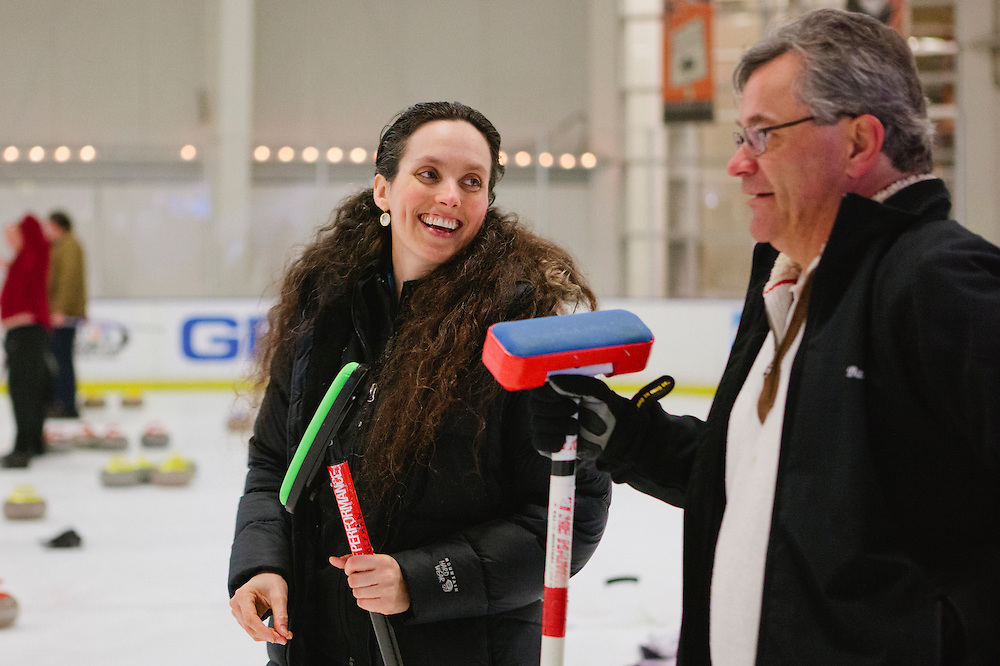 Gabrielle Coleman of Mountain View chats with Barry Ivy of Livermore during the San Francisco Bay Area Curling Club's Tuesday night league at Sharks Ice in San Jose on Jan.15, 2013.