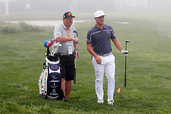 June 12, 2019 - Pebble Beach, CA, U.S. - PEBBLE BEACH, CA - JUNE 12: PGA golfer Bryson DeChambeau plays the 18th hole in the fog during a practice round for the 2019 US Open on June 12, 2019, at Pebble Beach Golf Links in Pebble Beach, CA. (Photo by Brian Spurlock/Icon Sportswire) (Credit Image: © Brian Spurlock/Icon SMI via ZUMA Press)