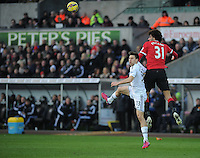 Swansea City's Federico Fernandez vies for possession with Manchester United's Marouane Fellaini<br /> <br /> Photographer Ashley Crowden/CameraSport<br /> <br /> Football - Barclays Premiership - Swansea City v Manchester United - Saturday 21st February 2015 - Liberty Stadium - Swansea<br /> <br /> © CameraSport - 43 Linden Ave. Countesthorpe. Leicester. England. LE8 5PG - Tel: +44 (0) 116 277 4147 - admin@camerasport.com - www.camerasport.com