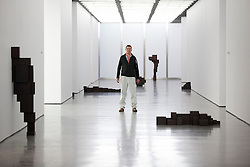 © Licensed to London News Pictures. 27/12/2012. London, UK. Artist Anthony Gormely poses with some his sculptures at an exhibition of his work at the White Cube gallery in London today (27/11/12). The exhibition, entitled 'Model', runs from 28th November 2012 to 10th February 2013 at the White Cube's Bermondsey Gallery. Photo credit: Matt Cetti-Roberts/LNP
