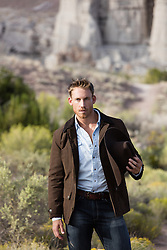 handsome cowboy outdoors on a rugged Western ranch in New Mexico