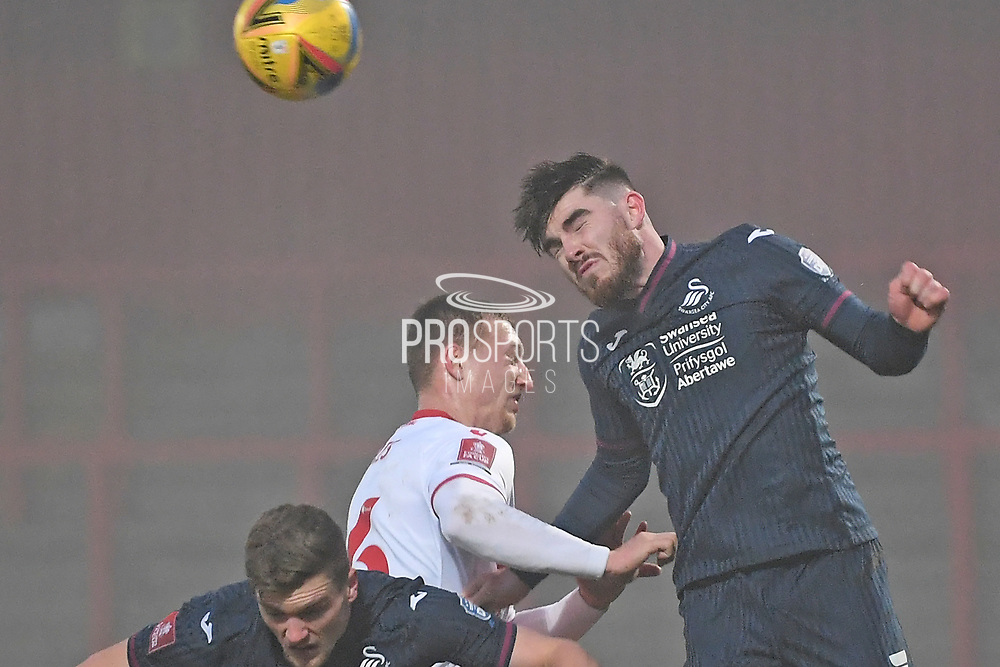 Swansea City midfielder Ryan Manning(3) heads the ball during the FA Cup match between Stevenage and Swansea City at the Lamex Stadium, Stevenage, England on 9 January 2021.