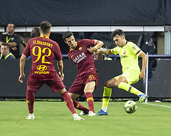 July 31, 2018 - Arlington, Texas, U.S.A - A.S. Roma player attempting to steal the ball from FC Barcelona player (Credit Image: © Hoss McBain via ZUMA Wire)