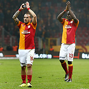 Galatasaray's Wesley Sneijder (L) and Dany Achille Nounkeu Tchounkeu (R) celebrate victory during their Turkish Superleague soccer match Galatasaray between Orduspor at the AliSamiyen Spor Kompleksi TT arena in Istanbul Turkey on Monday 25 February 2013. Photo by Aykut AKICI/TURKPIX