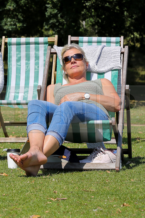 © Licensed to London News Pictures. 22/08/2019. London, UK. Kirsten from Germany enjoys the warm and sunny weather in London's Hyde Park. According to the Met Office, the temperatures are forecast to increase to 30 degrees celsius over the bank holiday weekend. <br /> <br /> ***Permission Granted***<br /> <br /> Photo credit: Dinendra Haria/LNP