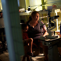 A patient has an eye exam at the Remote Area Medical clinic in Wise, Virginia July 20, 2012.  Organizers hope to bring free medical, dental and vision care to more than 3500 uninsured and underinsured people in the rural Virginia area.
