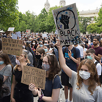 Demonstrators hold placards during a protest against racial inequality in the aftermath of the death in Minneapolis police custody of George Floyd, in front of the U.S. Embassy in Budapest, Hungary on June 7, 2020. ATTILA VOLGYI