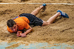 Lars van Vught in action on long jump during the Dutch Athletics Championships on 13 February 2021 in Apeldoorn