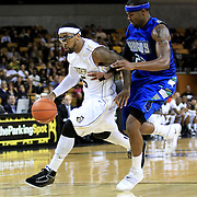 Marcus Jordan (5) of the University of Central Florida Knights mens basketball team dribbles the ball past Marquis Mathis (23) of the West Florida Argonauts in the first home game of the 2010 season at the UCF Arena on November 12, 2010 in Orlando, Florida. UCF won the game 115-61. (AP Photo/Alex Menendez)