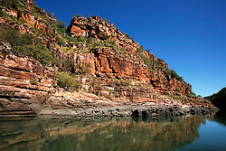 Dramatic red cliffs line the Sale River.