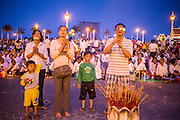 "29 JANUARY 2013 - PHNOM PENH, CAMBODIA:   A family prays for late Cambodian King Norodom Sihanouk on the plaza in front of the Royal Palace in Phnom Penh. Sihanouk (31 October 1922 - 15 October 2012) was the King of Cambodia from 1941 to 1955 and again from 1993 to 2004. He was the effective ruler of Cambodia from 1953 to 1970. After his second abdication in 2004, he was given the honorific of ""The King-Father of Cambodia."" Sihanouk held so many positions since 1941 that the Guinness Book of World Records identifies him as the politician who has served the world's greatest variety of political offices. These included two terms as king, two as sovereign prince, one as president, two as prime minister, as well as numerous positions as leader of various governments-in-exile. He served as puppet head of state for the Khmer Rouge government in 1975-1976. Most of these positions were only honorific, including the last position as constitutional king of Cambodia. Sihanouk's actual period of effective rule over Cambodia was from 9 November 1953, when Cambodia gained its independence from France, until 18 March 1970, when General Lon Nol and the National Assembly deposed him. Upon his final abdication, the Cambodian throne council appointed Norodom Sihamoni, one of Sihanouk's sons, as the new king. Sihanouk died in Beijing, China, where he was receiving medical care, on Oct. 15, 2012. His cremation is scheduled to take place on Feb. 4, 2013. Over a million people are expected to attend the service.     PHOTO BY JACK KURTZ"
