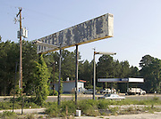 abandoned gasoline station sign with new gas station in the background route 301 Georgia border South Carolina USA