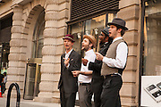 "A barbershop quartet sang ""Standing on the corner, watching all the girls go by"" to open the performance and to set the theme for the dance."
