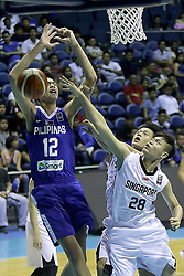 QUEZON Quezon City, May 14, 2017  Kai Sotto of the Philippines (L) competes against players from Singapore during their match in the 2017 SEABA junior men's championship tournament in Quezon City, the Philippines, May 14, 2017. The Philippines won, 108-42.  2017?5?14? (Credit Image: © Rouelle Umali/Xinhua via ZUMA Wire)