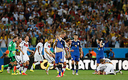 Argentina's Rodrigo Palacio shows dejection at full time a Germany celebrate victory during the 2014 FIFA World Cup Final match at Maracana Stadium, Rio de Janeiro<br /> Picture by Andrew Tobin/Focus Images Ltd +44 7710 761829<br /> 13/07/2014