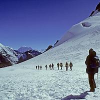 NEPAL, HIMALAYA. Trekking group crosses 17,782' Cho La pass between Gokyo & Khumbu Valleys, Khumbu region. 23,390' Baruntse bkg.