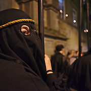 Farricocos, the masked penitents of Ecce Homo procession, with the fogaréus: the metal burning baskets.