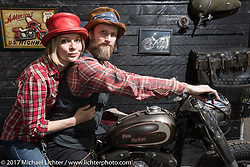 Tamara  and Alexander Ladutko made the custom hats they are wearing here for their company Ladtoma, which had a great display in the Custom and Tuning Show, the custom bike show portion of the big Motor Spring bike show in Moscow, Russia. Sunday April 23, 2017. Photography ©2017 Michael Lichter.